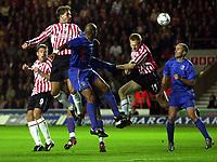 Photo: Richard Lane.<br />Southampton v Steaua Bucharest. UEFA Cup. 24/09/2003.<br />Claus Lundekvan heads in on goal.