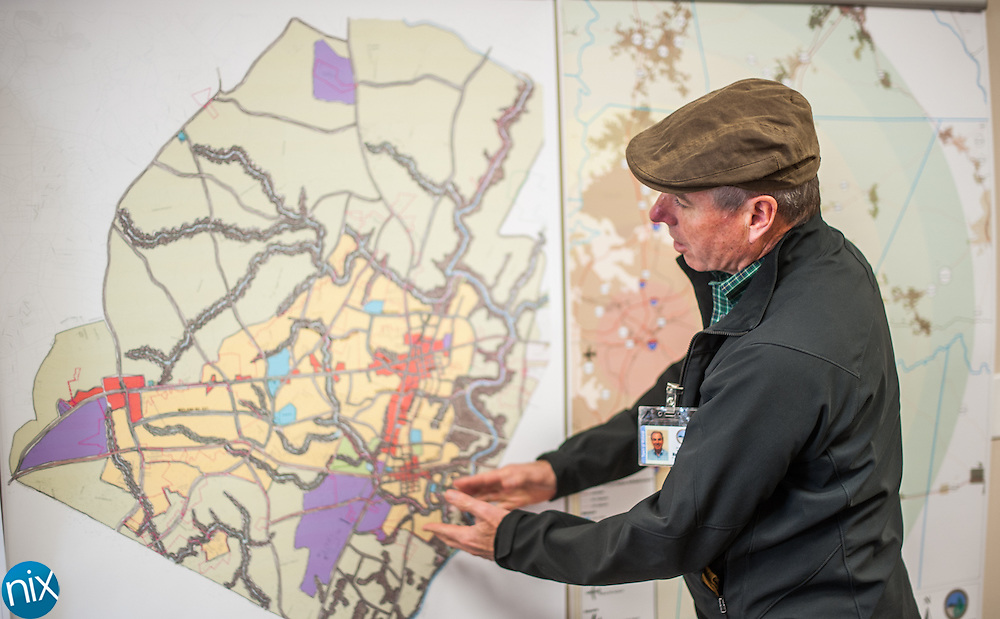 Midland town planner Richard Flowe points out where a new sewer line is going that will help spur development in the area.
