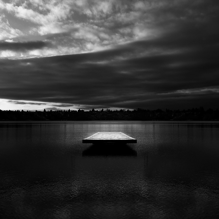 Partially mirrored image of a snow-covered swimming platform in Green Lake, Seattle, Washington. (digital art)