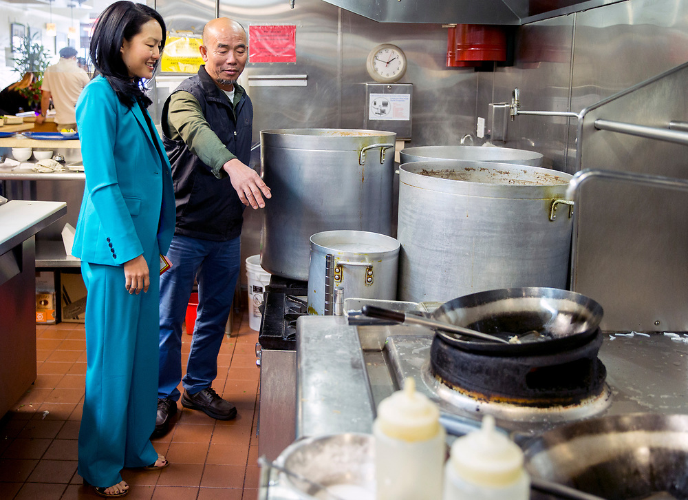 From left: Jane Kim and Turtle Tower chef and owner Steven Nghia Pham in the restaurant's kitchen, Tuesday, Feb. 20, 2018, in San Francisco, Calif. Kim, a Board of Supervisors member representing District 6, is running for mayor.