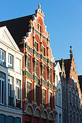 Traditional architecture windows and stepped gables of row of houses in Bruges - Brugge - Belgium