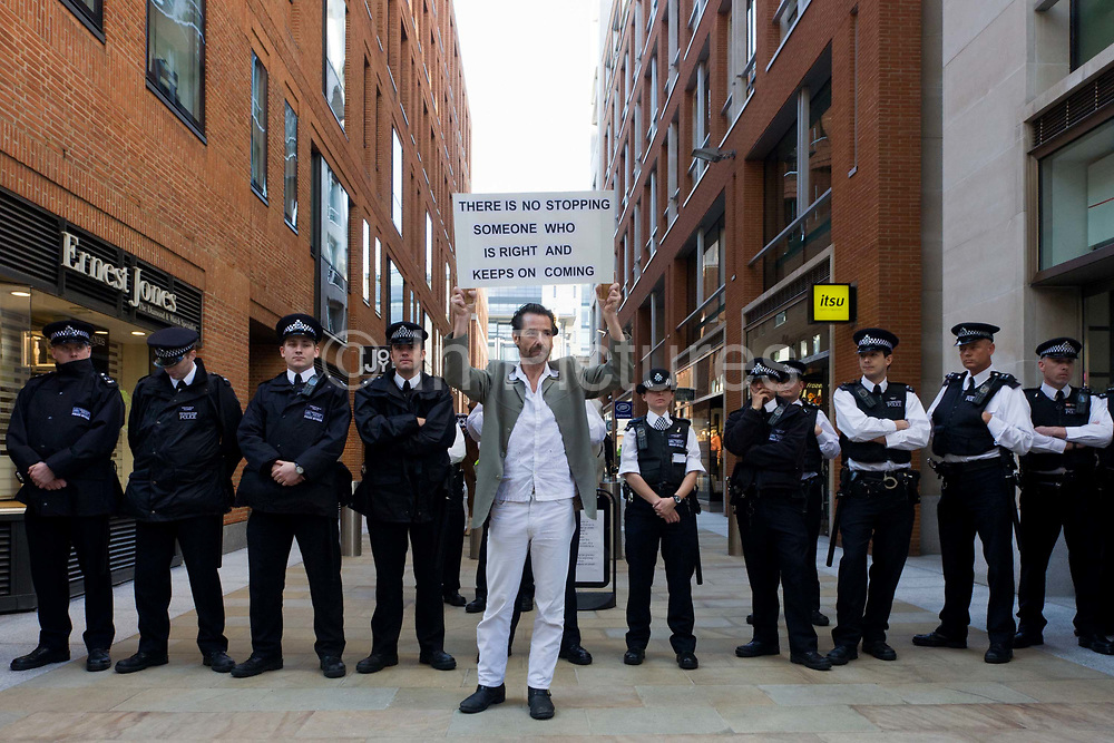 Metropolitan police officers guard the Stock Exchange area of Paternoster Square in the City of London during world corporate greed and government austerity measures protests.