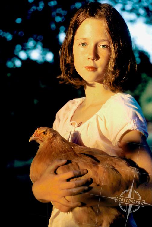 Girl holding pet chicken