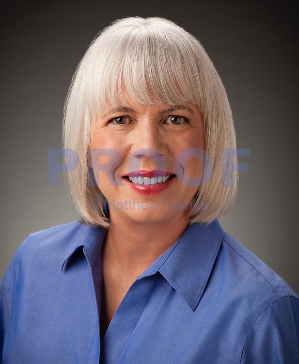 Photo of a business woman by Austin Headshot Photographer Matthew Lemke