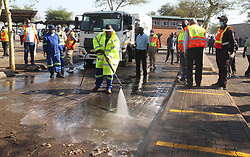 South Africa - Pretoria - 11 May 2020 - Gauteng transport MEC Jacob Mamabolo helps out sanitizing Mabopane taxi rank during a visit to ensure that lockdown regulations are being followed.<br /> Picture: Jacques Naude/African News Agency(ANA)