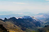 This is a ridge on Steens Mountain in SouthEastern Oregon, showing the vastness and emptyness of the landscape which fades away into the distance. The colors are soft and subtle.