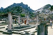 Tourists exploring Roman archaeological site at Glanum, St-Remy-de-Provence, France 1975