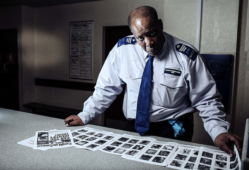 """Portraits of Idris Bada (Custody team 2 Charing Cross police station, on Thursday 3 October, 2013.<br /> <br /> Idris is a police super recogniser matching and  cross references & remembering villains that come out on a weekly met magazine called """"Caught on Camera""""."""