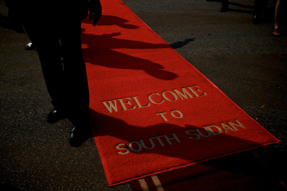 A security personal takes guard of the red carpet laid to receive international delegates attending the official ceremony marking South Sudan as an independent nation.