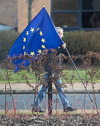 © Licensed to London News Pictures . 10/01/2019. Wakefield, UK. A man paces back and forth carrying an EU flag , on the road outside the factory , as Jeremy Corbyn delivers a speech about Brexit at OE Electronics in Calder Park , West Yorkshire , in which he calls for a new General Election if Prime Minister Theresa May's Brexit plan is rejected by Parliament . Photo credit: Joel Goodman/LNP