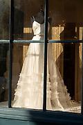 Wedding dress in shop window Amelia and Alci bridal boutique shop, Market Hill, Woodbridge, Suffolk, England, UK