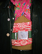 Detail of Aziz's jacket..Qyzyl Qorum campment, Abdul Rashid Khan's camp (leader of the Afghan Kyrgyz). .Winter expedition through the Wakhan Corridor and into the Afghan Pamir mountains, to document the life of the Afghan Kyrgyz tribe. January/February 2008. Afghanistan
