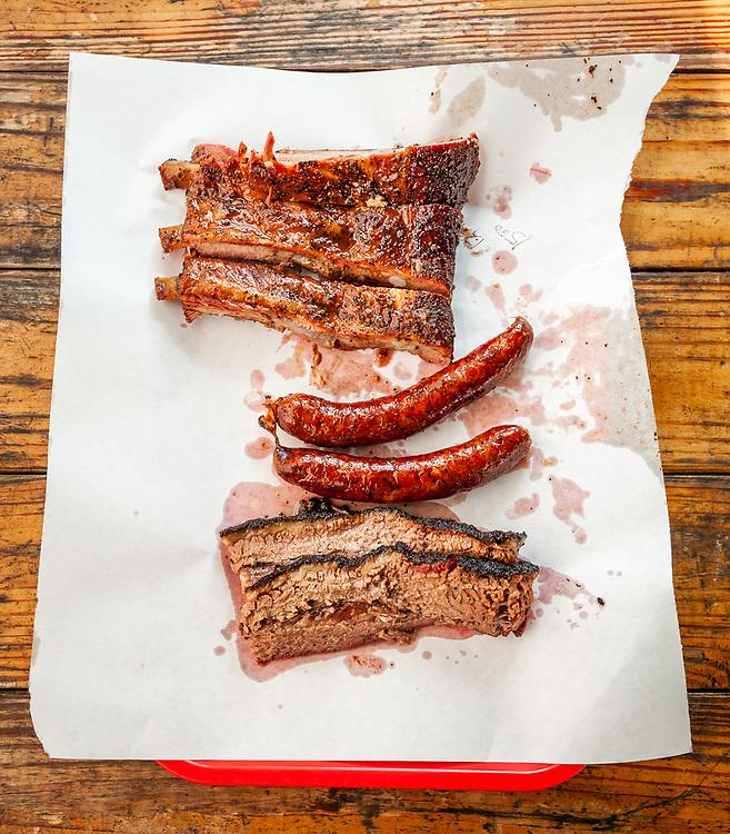 The Texas Holy Trinity of BBQ. Pork Ribs, Sausage and Brisket.