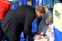 QPR's manager Harry Redknapp signs an autograph for a fan - Photo mandatory by-line: Mitchell Gunn/JMP - Tel: Mobile: 07966 386802 29/03/2014 - SPORT - FOOTBALL - Loftus Road - London - Queens Park Rangers v Blackpool - Championship