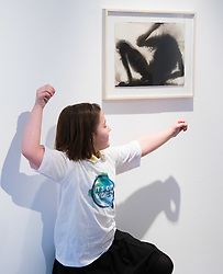 "Christies, St James, London, March 4th 2016. Nine year-old Ashley Hubbard from Charlton Manor Primary School mimics the shadowy shapes in  Sir Anthony Gormley's ""Wound"" from 2014, at the preview for the It's Our World charity auction at Christie's. Over 40 leading artists including David Hockney, Sir Antony Gormley, David Nash, Sir Peter Blake, Yinka Shonibare, Sir Quentin Blake, Emily Young and Maggi Hambling have committed artworks to the It's Our World Auction in support of The Big Draw and Jupiter Artland Foundation, to be sold at Christie's London on 10 March 2016.<br />  ///FOR LICENCING CONTACT: paul@pauldaveycreative.co.uk TEL:+44 (0) 7966 016 296 or +44 (0) 20 8969 6875. ©2015 Paul R Davey. All rights reserved."