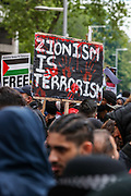 """London, United Kingdom, May 22, 2021: Protesters hold placards and banners outside Israeli Embassy in London during a demonstration """"For Palestine"""" on Saturday, May 22, 2021, as they take part in a rally supporting Palestinians. Egyptian mediators held talks on Saturday to firm up an Israel-Hamas cease-fire as Palestinians in the Hamas-ruled Gaza Strip began to assess the damage from 11 days of intense Israeli bombardment. Fresh clashes broke out at the Al-Aqsa Mosque compound in Jerusalem on Friday, just hours after a cease-fire between Israel and the Palestinian militant group Hamas took effect. (Photo by Vudi Xhymshiti/VXP)"""