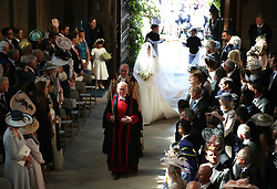 Meghan Markle and her bridal walk down the aisle of St George's Chapel at Windsor Castle for her wedding to Prince Harry.