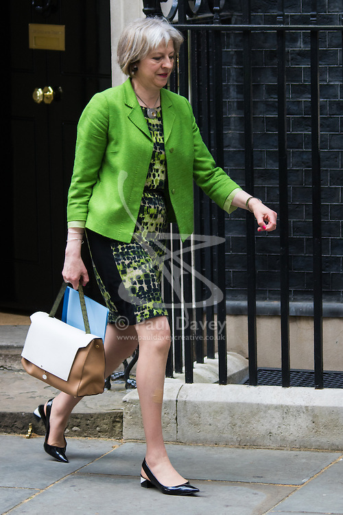 Downing Street, London, May 12th 2015. The all-conservatives Cabinet ministers gather for their first official meeting at Downing Street. PICTURED: Home Secretary Theresa May