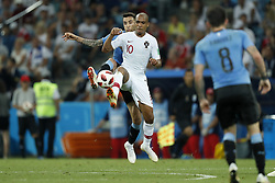 (L-R) Matias Vecino of Uruguay, Joao Mario of Portugal during the 2018 FIFA World Cup Russia round of 16 match between Uruguay and at the Fisht Stadium on June 30, 2018 in Sochi, Russia