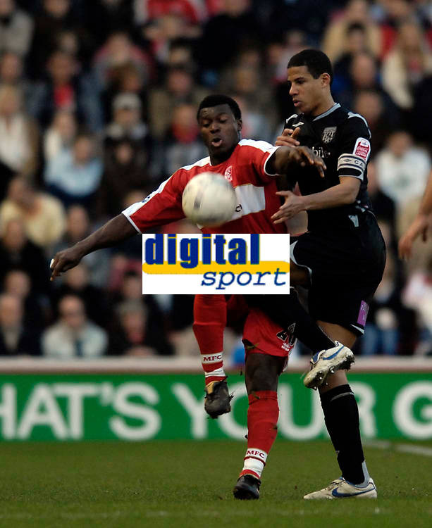 Photo: Jed Wee/Sportsbeat Images.<br /> Middlesbrough v West Bromwich Albion. The FA Cup. 17/02/2007.<br /> <br /> Middlesbrough's Yakubu (L) holds of West Brom's Curtis Davies.