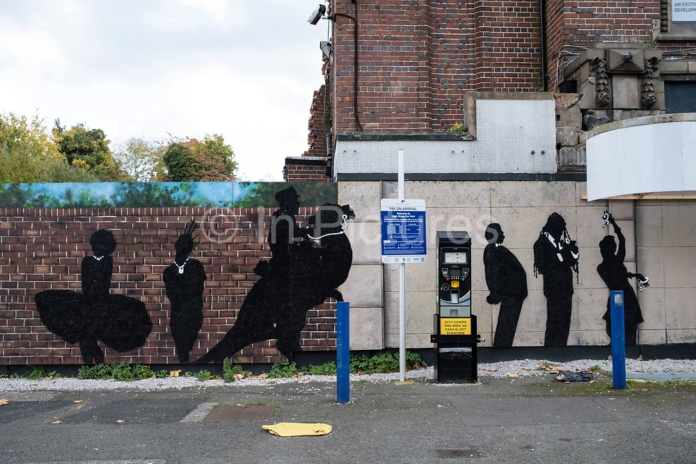 Silhouettes of famous characters / film actors from the big screen painted onto a wall of the Kingsway, a derelict former cinema where outdoor screenings are now being show in Kings Heath on 20th October 2020 in Birmingham, United Kingdom.