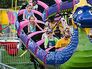 """26 JUNE 2019 - CENTRAL CITY, IOWA: Teenagers ride the """"Dragon Wagon"""" on the midway at the Linn County Fair. Summer is county fair season in Iowa. Most of Iowa's 99 counties host their county fairs before the Iowa State Fair, August 8-18 this year. The Linn County Fair runs June 26 - 30. The first county fair in Linn County was in 1855. The fair provides opportunities for 4-H members, FFA members and the youth of Linn County to showcase their accomplishments and talents and provide activities, entertainment and learning opportunities to the diverse citizens of Linn County and guests.    PHOTO BY JACK KURTZ"""