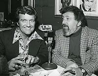 1978 Radio commentator and interviewer, Gregg Hunter, seen interviewing composer, Mitch Leigh, during his KIEV radio show at the Brown Derby Restaurant on Vine St. in Hollywood