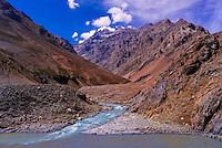 Confluence of the Shingo River (in front) and Indus River (behind, coming from Pakistan); Ladakh; Jammu and Kashmir State, India.