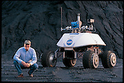 """Not long before going to Antarctica, William L. """"Red"""" Whittaker took a rare moment off from his busy schedule to accompany Nomad, his meteorite-hunting robot, on a practice run. The robot spent Antarctica's summer of 2000 on the ice, hunting for meteorites. With its onboard instruments, Nomad found and classified five. It was the first time that a machine autonomously made a scientific discovery. Pittsburgh, PA. From the book Robo sapiens: Evolution of a New Species, page 138-139."""