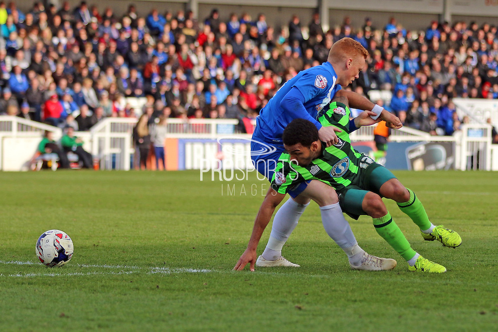 Hartlepool United midfielder Michael Woods (14) and Andy Barcham midfielder for AFC Wimbledon (17) tussle during the Sky Bet League 2 match between Hartlepool United and AFC Wimbledon at Victoria Park, Hartlepool, England on 25 March 2016. Photo by Stuart Butcher.