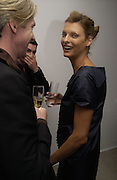 Philip Treacy and Linda Evangelista, Party hosted by Linda Evangelista and Mac Cosmetics. The Hospital. London. 18 September 2005. ONE TIME USE ONLY - DO NOT ARCHIVE © Copyright Photograph by Dafydd Jones 66 Stockwell Park Rd. London SW9 0DA Tel 020 7733 0108 www.dafjones.com