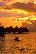 Image of overwater bungalows with kayakers on Bora Bora, Tahiti, French Polynesia by Randy Wells