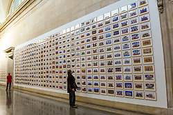 "© Licensed to London News Pictures. 11/11/2019. LONDON, UK. Visitors view works at the preview of ""Year 3"", an exhibition by Turner Prize-winning artist and Oscar-winning filmmaker Steve McQueen at Tate Britain.  The artwork comprises 3,128 traditional school class photographs of Year 3 pupils from 1,504 of London's primary schools.  The work reflects a picture of the present and is on display 12 November to 3 May 2020.  Photo credit: Stephen Chung/LNP"