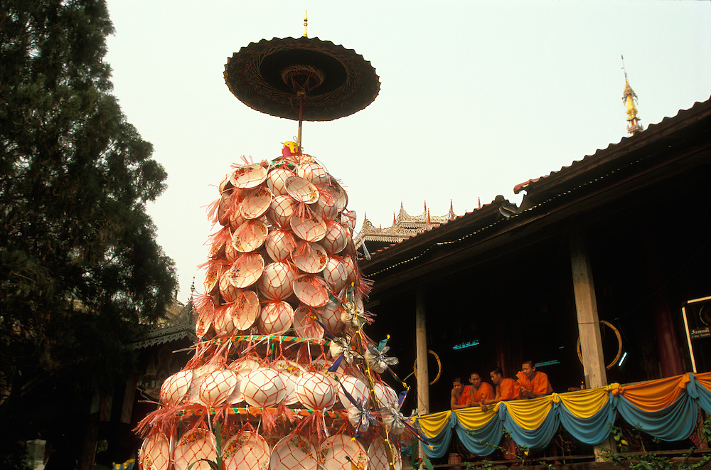 A tapesa, a mound of plates, given as an offering to the temple during Poy Sang Long, the yearly ordination of novice monks, Mae Hong Son, Thailand.