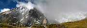 Panoramic view of the rock memorial to Quintin MacKinnon, who first made the Milford Track along the Arthur and Clinton Rivers; Fiordland National Park, Southland, New Zealand