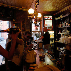 Inside the Lost Horse Saloon, in Baltimore's popular and historic Fell's Point district, weekend revelers enjoy beers and comaraderie...Photo by Susana Raab