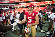 San Francisco 49ers punter Bradley Pinion (5) talks with Houston Texans players after a preseason game at Levi's Stadium in Santa Clara, Calif., on August 14, 2016. (Stan Olszewski/Special to S.F. Examiner)