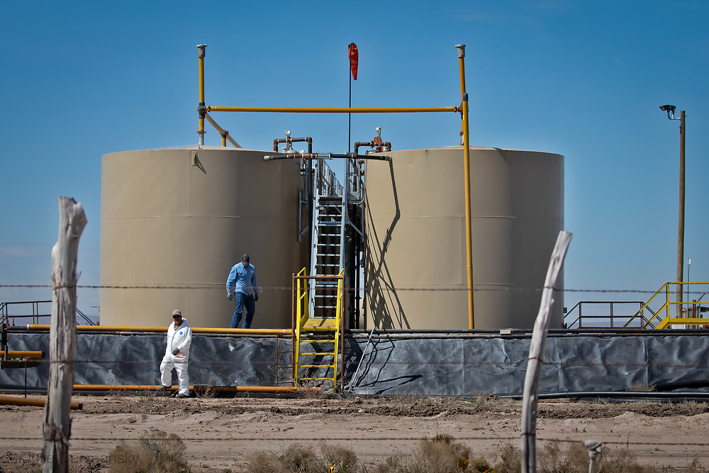 Worker at an Oil and gas industry site near Penny Aucoin and  Carl George's home in New Mexico's Permain Basin.