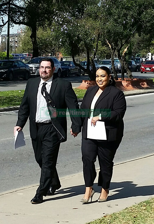 March 2, 2017 - San Antonio, Texas - ERIC JON ALVA and JESSICA RIVAS ALVA leave federal court in San Antonio on Thursday after pleading guilty to defrauding immigrants. A San Antonio couple was sentenced Thursday to six months in prison for defrauding immigrants out of thousands of dollars that the pair used for luxuries that included prime Spurs tickets and designer shoes. Eric Jon Alva, 39, and Jessica Rivas Alva, 37, pleaded guilty in March to conspiracy to commit wire theft and aggravated identity theft. The pair admitted that between March 2015 and May 2015, they conspired to collect legal fees from incarcerated immigrants and their families using false pretenses.  (Credit Image: © Guillermo Contreras/San Antonio Express-News/ZUMAPRESS.com)