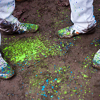 London, UK - 23 March 2013: painted shoes of partygoers during  the Holi Spring Festival of Colour takes place at Orleans House Gallery in Twickenham. The annual event marks the end of Winter and welcomes the joy of spring.