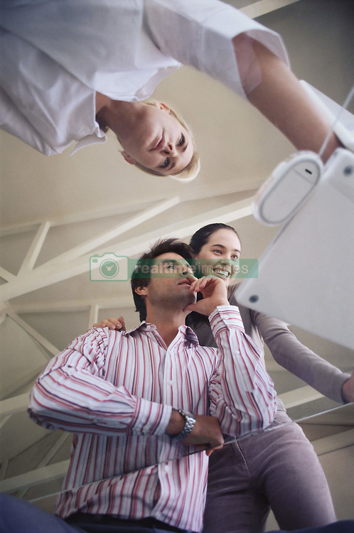 Dec. 14, 2012 - People working on a glass table (Credit Image: © Image Source/ZUMAPRESS.com)