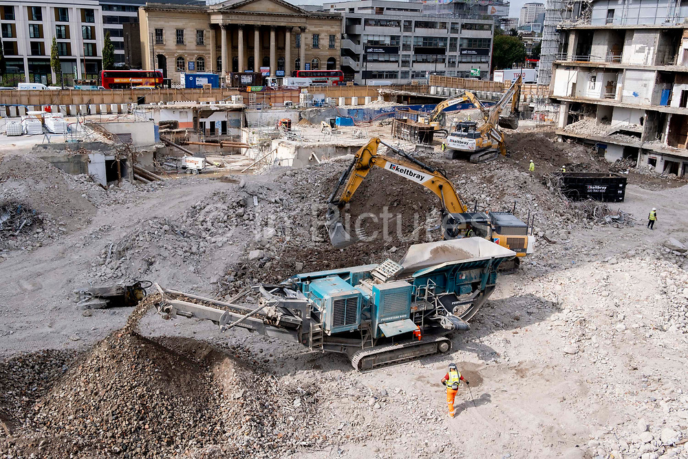 The changing urban landscape during the ongoing clearance of the site of the former Elephant & Castle shopping centre which is being demolished and redeveloped in south London, on 13th September 2021, in London, England. The much-criticised architecture of the Elephant & Castle Shopping Centre was opened in 1965, built on the bomb damaged site of the former Elephant & Castle Estate, originally constructed in 1898. The centre was home to restaurants, clothing retailers, fast food businesses and clubs where south Londoners socialised and met lifelong partners.