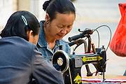 China, Xian, seamstress at an outdoor street market