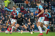 Barnsley midfielder Cameron McGeehan (8) is fouled by Burnley midfielder Jeff Hendrick (13) during the The FA Cup 3rd round match between Burnley and Barnsley at Turf Moor, Burnley, England on 5 January 2019.