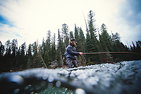 Man fly fishing in the Box Canyon section of the Henry's Fork of the Snake in NE Idaho.