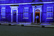 A candle is seen on the doorstep of 10 Downing Street as it's lit up blue on July 4, 2020, in London, United Kingdom. Sunday marks the 72nd anniversary of the formation of the National Health Service (NHS). British Landmarks and some football stadiums will be lit up blue as a mark of support and gratitude for the NHS. The UK has hailed its NHS for the work they have done during the Covid-19 pandemic. (VXP Photo/ Vudi Xhymshiti)