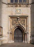 Ornate clock wooden doorway Church of St Mary the Great, Cambridge, England