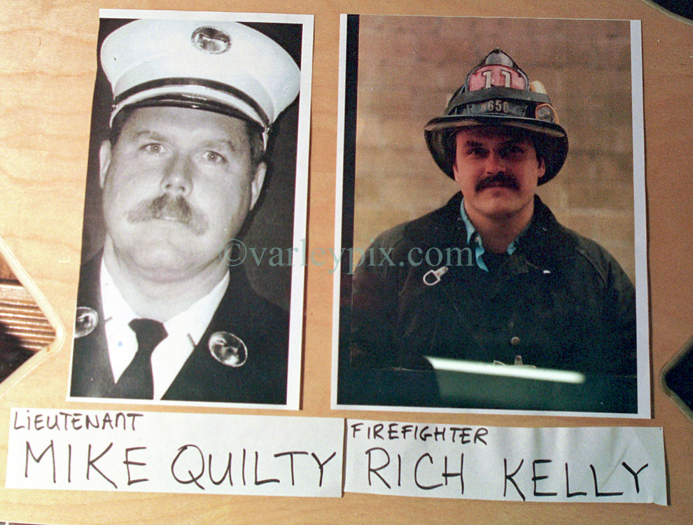 14 September 2001. New York, New York - USA.<br /> Post 9/11 World Trade Center attack.<br /> Mike Quilty and Rich Kelly, firefighters. Missing presumed dead. Hero firefighter, colleagues of Mike Kehoe of Engine 28, Ladder 11 pictured in a memorial erected at their firehouse on East 2nd Street in the East village early in the morning of Sept 14th. <br /> Mike Kehoe's image had been published the day before on front pages around the world. It is the iconic image of him ascending the stairs of the World Trade Center as he helped to evacuate people from the terrorist attacks of 9/11. It was assumed Mike had perished when the buildings collapsed. However Mike had miraculously managed to escape the buildings moments before they collapsed. 6 members of his crew were not so fortunate. Mike became a symbol of heroism to many following the vicious Al Queda attacks which claimed over 2,000 victims at the WTC site. This images was published exclusively on the Front Page of the Daily Mirror on 15th Sept, 2001.<br /> Photo exclusive©; Charlie Varley/varleypix.com