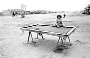 Young girl sitting on Pool Table 1