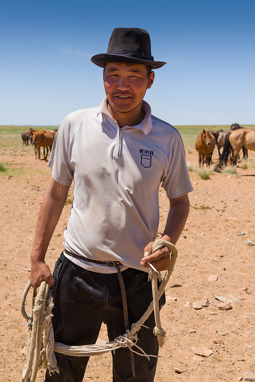 Portrait of a wrangler and his horses in Dundgov Province, Mongolia. Photo ©robertvansluis.com